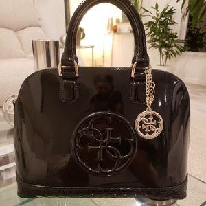 EUC - Guess Amy black patent dome logo satchel